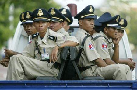 Cambodian police wearing official shirt on duty