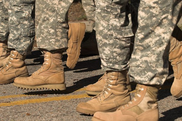 boots of soldiers walking in formation