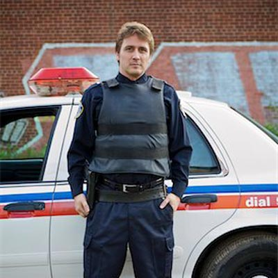 police-wearing-the-bulletproof-vest-by-the-car